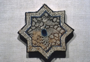 <em>Eight-Pointed Star Tile with Simurgh (Phoenix)</em>, late 13th century. Ceramic; fritware, painted in luster and blue over an opaque white glaze, 8 x 8in. (20.3 x 20.3cm). Brooklyn Museum, Gift of the Ernest Erickson Foundation, Inc., 86.227.72. Creative Commons-BY (Photo: Brooklyn Museum, 86.227.72.jpg)