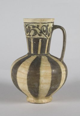 <em>Jug</em>, mid-12th century. Ceramic; earthenware, painted in black slip and white engobe under a transparent glaze, 6 3/4 x 4 1/2 in. (17.2 x 11.5 cm). Brooklyn Museum, Gift of the Ernest Erickson Foundation, Inc., 86.227.77. Creative Commons-BY (Photo: Brooklyn Museum, 86.227.77_PS5.jpg)