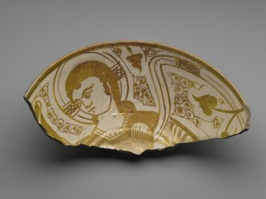 <em>Fragment of a Bowl</em>, 11th century. Ceramic, monochrome lusterware, pink earthenware body, 3 3/8 x 5 1/8 x 9 7/16 in. (8.6 x 13 x 24 cm). Brooklyn Museum, Gift of the Ernest Erickson Foundation, Inc., 86.227.81. Creative Commons-BY (Photo: Brooklyn Museum, 86.227.81_PS6.jpg)