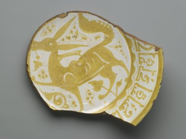 <em>Fragment of a Plate</em>, 11th century. Ceramic, monochrome lusterware, pink earthenware body, Diameter: 8 5/8 x 2 5/16 in. (21.9 x 5.8 cm). Brooklyn Museum, Gift of the Ernest Erickson Foundation, Inc., 86.227.82. Creative Commons-BY (Photo: Brooklyn Museum, 86.227.82_PS6.jpg)