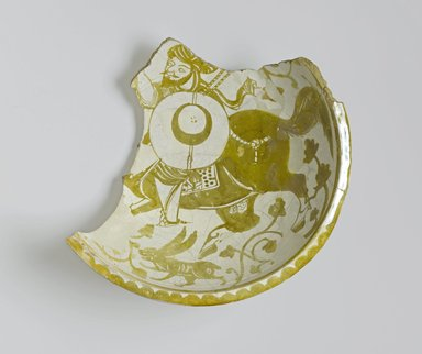 <em>Fragment of a Bowl Depicting a Mounted Warrior</em>, 11th century. Ceramic; earthenware, painted in luster on an opaque white glaze, 15 1/2 x 15 1/2in. (39.4 x 39.4cm). Brooklyn Museum, Gift of the Ernest Erickson Foundation, Inc., 86.227.83. Creative Commons-BY (Photo: Brooklyn Museum, 86.227.83_top_PS1.jpg)