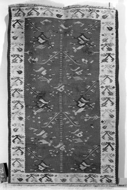 <em>Prayer rug</em>, 19th century. Wool, kilim, Old Dims: 61 x 39 in. (154.9 x 99.1 cm). Brooklyn Museum, Gift of the Ernest Erickson Foundation, Inc., 86.227.95. Creative Commons-BY (Photo: Brooklyn Museum, 86.227.95a_overall_acetate_bw.jpg)