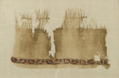 <em>Tiraz Textile Fragment</em>, 11th century. Linen, tapestry-woven decoration, 13 1/4 x 7in. (33.7 x 17.8cm). Brooklyn Museum, Gift of the Ernest Erickson Foundation, Inc., 86.227.98. Creative Commons-BY (Photo: Brooklyn Museum, 86.227.98_PS1.jpg)