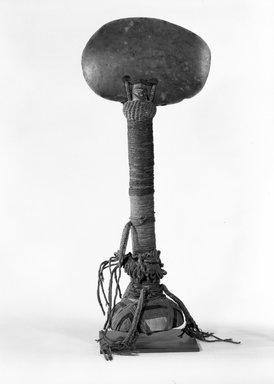 "Kanak. <em>Ceremonial Ax (Gi Okono)</em>. Wood, cloth, coir, greenstone, H: 20"" W: 8"". Brooklyn Museum, Gift of Evelyn A. J. Hall and John A. Friede, 86.229.1. Creative Commons-BY (Photo: Brooklyn Museum, 86.229.1_bw.jpg)"