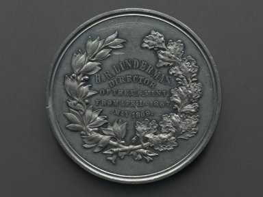 William Barber (American, born England, 1807-1879). <em>Henry R. Linderman Medal</em>, ca. 1869. Silver-plated metal, 3 x 3 x 5/16 in. (7.6 x 7.6 x 0.8 cm). Brooklyn Museum, Gift of M. Christman Zulli, 86.248.2. Creative Commons-BY (Photo: Brooklyn Museum, 86.248.2_bottom_PS2.jpg)