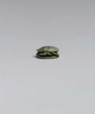 <em>Scarab</em>, ca. 1292-1075 B.C.E. Steatite, glaze, 1 9/16 x 1/4 x 3/8 in. (4 x 0.7 x 0.9 cm). Brooklyn Museum, Gift of Jerome A. and Mary Jane Straka, 86.252.10. Creative Commons-BY (Photo: Brooklyn Museum, 86.252.10_left_PS2.jpg)