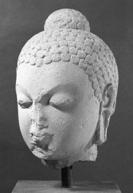 <em>Head of Buddha</em>, 5th century C.E. Sandstone, 17 x 10 1/4 x 10 1/2 in., 71 lb. (43.2 x 26 x 26.7 cm, 32.21kg). Brooklyn Museum, Gift of Mr. and Mrs. Paul E. Manheim, 86.272. Creative Commons-BY (Photo: Brooklyn Museum, 86.272_bw.jpg)