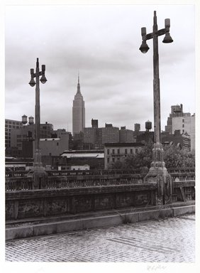Irwin Silver (American, born 1945). <em>Lampposts, Empire State Building, Westside Highway, New York</em>, 1977. Selenium-toned gelatin silver photograph, Image: 7 13/16 x 5 1/2 in. (19.8 x 14 cm). Brooklyn Museum, Gift of the artist, 86.55. © artist or artist's estate (Photo: , 86.55_PS11.jpg)