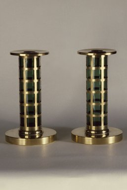 Pairpoint Manufacturing Company (1880-1929). <em>Candlestick, One of Pair</em>, ca. 1912. Brass and glass, 7 x 4 in. (17.8 x 10.2 cm). Brooklyn Museum, Designated Purchase Fund, 86.80.1. Creative Commons-BY (Photo: , 86.80.1_86.80.2_reference_SL1.jpg)