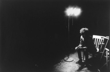 Nat Finkelstein (American, 1933-2009). <em>Dylan Under Spot Bob Dylan</em>, 1966. Gelatin silver photograph, image: 22 3/4 x 15 in. (57.8 x 38.1 cm). Brooklyn Museum, Gift of the son of Abe and Esther Finkelstein, a Brooklyn cab driver and his wife, 87.150.1. © artist or artist's estate (Photo: Brooklyn Museum, 87.150.1.jpg)