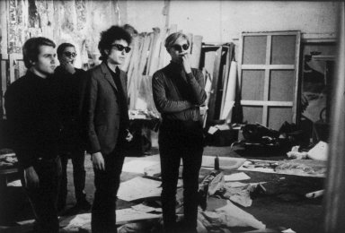 Nat Finkelstein (American, 1933-2009). <em>Dylan, Warhol, Malanga and Danny Williams</em>, 1965, printed 1987. Gelatin silver photograph, image: 15 1/2 x 22 3/4 in. (39.4 x 57.8 cm). Brooklyn Museum, Gift of the son of Abe and Esther Finkelstein, a Brooklyn cab driver and his wife, 87.150.2. © artist or artist's estate (Photo: Brooklyn Museum, 87.150.2.jpg)