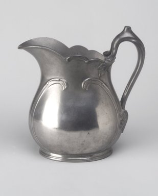 Reed & Barton (American, 1840-present). <em>Pitcher</em>, ca. 1908. Pewter, 8 1/4 x 8 x 4 1/2 in. (21 x 20.3 x 11.4 cm). Brooklyn Museum, Gift of Emma and Jay Lewis, 87.174. Creative Commons-BY (Photo: Brooklyn Museum, 87.174.jpg)