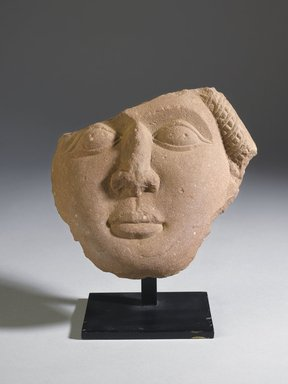 <em>Fragment of a Face</em>, 185-72 B.C.E. Sandstone relief, 6 1/8 x 6 11/16 x 2 3/16 in. (15.5 x 17 x 5.5 cm). Brooklyn Museum, Gift of Georgia and Michael de Havenon, 87.188.11. Creative Commons-BY (Photo: Brooklyn Museum, 87.188.11_front_PS4.jpg)