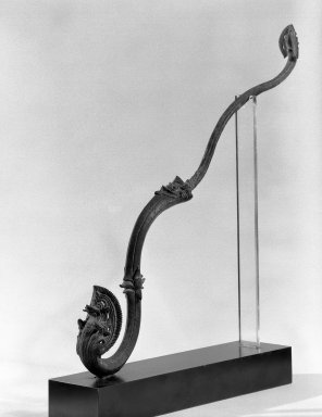 <em>Khmer Finial</em>, 12th century. Bronze, 13 3/8 x 12 1/4 in. (34 x 31.1 cm). Brooklyn Museum, Gift of Georgia and Michael de Havenon, 87.188.6. Creative Commons-BY (Photo: Brooklyn Museum, 87.188.6_bw.jpg)