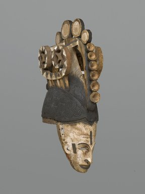 Igbo. <em>Maiden Spirit Helmet Mask (Agbogho Mmwo)</em>, early 20th century. Wood, pigment, string, 19 3/4 x 5 3/4 x 12 in. (50.2 x 14.6 x 30.5 cm). Brooklyn Museum, Gift of Marc and Ruth Franklin in memory of Lillian S. Korzenik, 87.215. Creative Commons-BY (Photo: Brooklyn Museum, 87.215_threequarter_PS1.jpg)