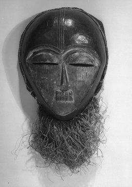 Ngbaka. <em>Mask</em>, 20th century. Wood, raffia fiber and cloth, 16 1/2 x 8 3/4 x 4 1/2 in. (42.0 x 22.2 x 11.5 cm). Brooklyn Museum, Gift of Dr. and Mrs. Abbott A. Lippman, 87.217.1. Creative Commons-BY (Photo: Brooklyn Museum, 87.217.1_bw.jpg)