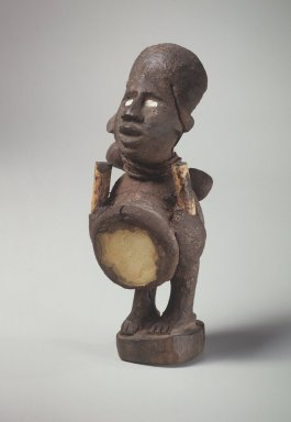 Kongo. <em>Figure (Nkisi)</em>, 19th or 20th century. Wood, glass, bamboo, string, resinous material, shell?, 5 1/2 x 2 1/4 x 2 3/8 in. (14 x 5.7 x 6.0 cm). Brooklyn Museum, Gift of Marcia and John Friede and Mrs. Melville W. Hall, 87.218.117. Creative Commons-BY (Photo: Brooklyn Museum, 87.218.117.jpg)