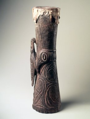 Iatmul. <em>Drum</em>, early 20th century. Wood, snake skin, coir, pigment, 24 1/2 x 6 x 7 in. (62.2 x 15.2 x 17.8 cm). Brooklyn Museum, Gift of Marcia and John Friede and Mrs. Melville W. Hall, 87.218.12. Creative Commons-BY (Photo: Brooklyn Museum, 87.218.12.jpg)