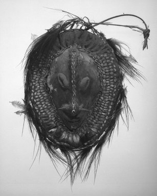 <em>Mask</em>. Cassowarey breast bone, shells, seeds, clay, feathers, teeth, wicker, 13 1/2 x 9 3/4 x 3 1/2 in. (34.3 x 24.8 x 8.9 cm). Brooklyn Museum, Gift of Marcia and John Friede and Mrs. Melville W. Hall, 87.218.27. Creative Commons-BY (Photo: Brooklyn Museum, 87.218.27_bw.jpg)