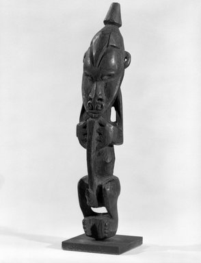 <em>Figure</em>. Wood, 7 5/8 x 1 1/2 x 1 3/8 in. (19.4 x 3.8 x 3.5 cm). Brooklyn Museum, Gift of Marcia and John Friede and Mrs. Melville W. Hall, 87.218.39. Creative Commons-BY (Photo: Brooklyn Museum, 87.218.39_bw.jpg)