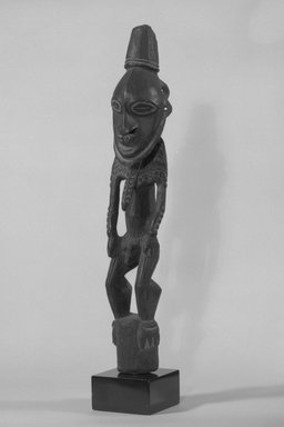 <em>Figure</em>. Wood, pigment, 17 7/8 x 3 1/2 x 3 1/2 in. (45.4 x 8.9 x 8.9 cm). Brooklyn Museum, Gift of Marcia and John Friede and Mrs. Melville W. Hall, 87.218.42. Creative Commons-BY (Photo: Brooklyn Museum, 87.218.42_threequarter_bw.jpg)