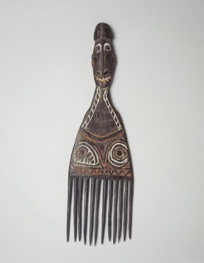 <em>Comb Surmounted by a Head</em>. Wood, pigment, 12 x 3 1/2 x 3/4 in. (30.5 x 8.9 x 1.9 cm). Brooklyn Museum, Gift of Marcia and John Friede and Mrs. Melville W. Hall, 87.218.54. Creative Commons-BY (Photo: Brooklyn Museum, 87.218.54.jpg)
