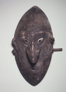 <em>Mask</em>, late 19th-early 20th century. Wood, clay, shell, pigment, bamboo, plant fiber, 19 1/4 x 11 1/4 x 6 in.  (48.9 x 28.6 x 15.2 cm). Brooklyn Museum, Gift of Marcia and John Friede and Mrs. Melville W. Hall, 87.218.62. Creative Commons-BY (Photo: Brooklyn Museum, 87.218.62.jpg)