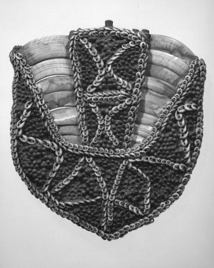 <em>Pectoral Ornament</em>. Boar tusk, bamboo, fiber, nassa shells, seeds, gum, 9 1/2 x 8 5/8 in. (24.1 x 21.9 cm). Brooklyn Museum, Gift of Marcia and John Friede and Mrs. Melville W. Hall, 87.218.72. Creative Commons-BY (Photo: Brooklyn Museum, 87.218.72_bw.jpg)