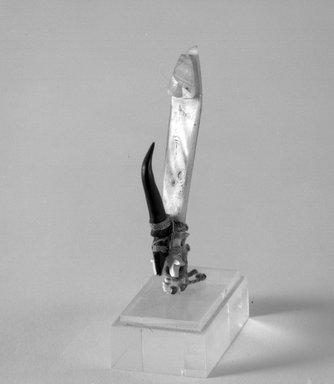 Solomon Islander. <em>Fishhook</em>. Pearl shell, tortoiseshell, string, 3 1/4 x 1/2 x 1 in. (8.3 x 1.3 x 2.5 cm). Brooklyn Museum, Gift of Marcia and John Friede and Mrs. Melville W. Hall, 87.218.77. Creative Commons-BY (Photo: Brooklyn Museum, 87.218.77_bw.jpg)