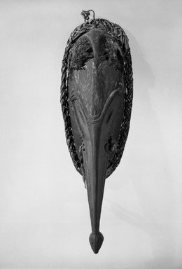 <em>Mask</em>, 20th century. Wood, fiber, pigment, shell, 13 1/4 x 5 x 3 1/8 in. (33.7 x 12.7 x 7.9 cm). Brooklyn Museum, Gift of Marcia and John Friede and Mrs. Melville W. Hall, 87.218.8. Creative Commons-BY (Photo: Brooklyn Museum, 87.218.8_bw.jpg)