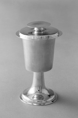 T.C.. <em>Chalice and Paten</em>. Silver, Chalice height: 6 1/8 in (15.6 cm): diameter of base: 3/8 in. (8.5 cm). Brooklyn Museum, Gift of Wunsch Foundation, Inc., 87.224.2a-b. Creative Commons-BY (Photo: Brooklyn Museum, 87.224.2a-b_bw.jpg)