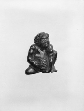 <em>Netsuke in the Form of a Korumbo (South Sea Islander)</em>, 19th century. Carved ebony and coral, 1 1/2 x 1 1/4 in. (3.8 x 3.2 cm). Brooklyn Museum, Gift of Maybelle M. Dore, 87.228.1. Creative Commons-BY (Photo: Brooklyn Museum, 87.228.1_bw.jpg)