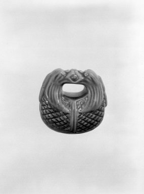 Eiraku. <em>Netsuke in the Form of a Mokugyo (Gong)</em>, 19th century. Glazed earthenware, 1 1/4 x 1 3/16 in. (3.2 x 3 cm). Brooklyn Museum, Gift of Maybelle M. Dore, 87.228.4. Creative Commons-BY (Photo: Brooklyn Museum, 87.228.4_bw.jpg)