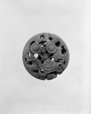 <em>Manju (Bun - Shaped) Netsuke Depicting a Snail Amid Flowers</em>, late 19th century. Carved antler with openwork relief, 3/4 x 1 1/2 in. (1.9 x 3.8 cm). Brooklyn Museum, Gift of Maybelle M. Dore, 87.228.6. Creative Commons-BY (Photo: Brooklyn Museum, 87.228.6_bw.jpg)
