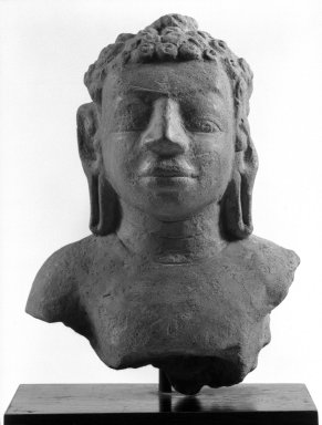 <em>Head and Upper Torso of a Buddha, Dvaravati Style</em>, 8th-9th century. Terra cotta, 7 1/2 x 5 1/2 x 3 1/4 in. (19.1 x 14 x 8.3 cm). Brooklyn Museum, Gift of Mr. and Mrs. Robert L. Poster, 87.234.2. Creative Commons-BY (Photo: Brooklyn Museum, 87.234.2_bw.jpg)