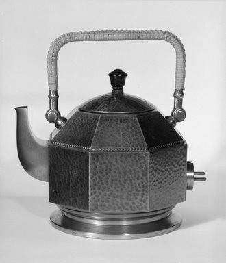 Peter Behrens (German, 1868-1940). <em>Electric Tea and Hot - Water Kettle with Lid</em>, ca. 1909. Hammered copper with wooden knob, 8 3/4 x 8 1/2 x 6 1/2 in. (22.2 x 21.6 x 16.5 cm). Brooklyn Museum, Gift of Zohar Ben-Dov, 87.70.1a-b. Creative Commons-BY (Photo: Brooklyn Museum, 87.70.1a-b_bw.jpg)