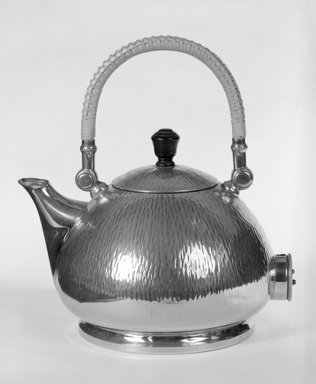 Peter Behrens (German, 1868-1940). <em>Electric Tea and Hot - Water Kettle with Lid</em>, ca. 1909. Nickel - plated brass with wooden knob, 8 3/4 x 8 x 6 1/4 in. (22.2 x 20.3 x 15.9 cm). Brooklyn Museum, Gift of Zohar Ben-Dov, 87.70.2. Creative Commons-BY (Photo: Brooklyn Museum, 87.70.2_bw.jpg)