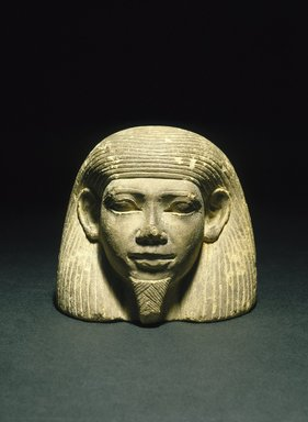 <em>Jar Lid with Human Face</em>, ca. 1876-1837 B.C.E. Limestone, 4 × 4 7/16 × 4 1/16 in. (10.2 × 11.2 × 10.3 cm). Brooklyn Museum, Purchased with funds given by Christos G. Bastis and Charles Edwin Wilbour Fund, 87.78. Creative Commons-BY (Photo: Brooklyn Museum, 87.78_SL1.jpg)