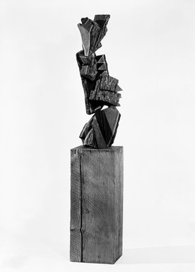 Mel Kendrick (American, born 1949). <em>Black Walnut with Bark</em>, 1986. Black walnut, 41 1/2 x 16 x 12 1/2 in. (105.4 x 40.6 x 31.8 cm). Brooklyn Museum, Purchased with funds given by Harry Kahn, 87.92a-b. © artist or artist's estate (Photo: Brooklyn Museum, 87.92a-b_bw_view2.jpg)