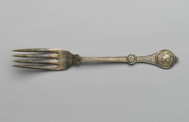 Henry G. Reed. <em>Dinner Fork, Roman Medallion Pattern</em>, Patented December 29, 1868. Silver plate, 7 9/16 x 1 x 3/4 in. (19.2 x 2.5 x 1.9 cm). Brooklyn Museum, Gift of Kate Carmel, 88.103. Creative Commons-BY (Photo: Brooklyn Museum, 88.103_PS2.jpg)