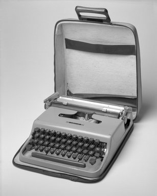 Marcello Nizzoli. <em>Portable Typewriter with Cover and Carrying Case</em>, 1950 (design); later manufacture. Painted metal, plastic, rubber, leatherette, 3 x 10 9/16 x 12 3/4 in. (7.6 x 26.8 x 32.4 cm). Brooklyn Museum, Anonymous gift, 88.106a-c. Creative Commons-BY (Photo: Brooklyn Museum, 88.106a-c_bw.jpg)