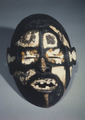 Idoma. <em>Face Mask</em>, early 20th century. Wood, pigment, 10 1/2 x 7 1/4 x 4 3/4 in. (26.8 x 18.4 x 12.1 cm). Brooklyn Museum, Gift of Eugene and Harriet Becker, 88.186. Creative Commons-BY (Photo: Brooklyn Museum, 88.186.jpg)