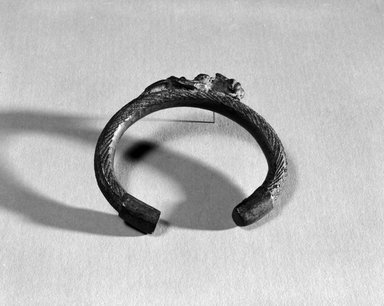 Lobi. <em>Bracelet with One Figure</em>, late 19th-early 20th century. Copper alloy, diam: 2 1/2 in. (6.4 cm). Brooklyn Museum, Gift of Dr. Arthur Dintenfass, 88.187.2. Creative Commons-BY (Photo: Brooklyn Museum, 88.187.2_bw.jpg)