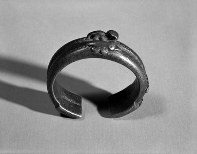 Senufo. <em>Bracelet with Two Animal Forms</em>, late 19th or early 20th century. Copper alloy, h: 3/4 in. (1.9 cm). Brooklyn Museum, Gift of Arthur Dintenfass, 88.187.3. Creative Commons-BY (Photo: Brooklyn Museum, 88.187.3_bw.jpg)
