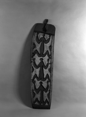 Asmat. <em>Shield</em>. Wood, pigment, 75 9/16 x 19 11/16 x 3 15/16 in. (192 x 50 x 10 cm). Brooklyn Museum, Gift of Gerald and Leona Shapiro, 88.191.4. Creative Commons-BY (Photo: Brooklyn Museum, 88.191.4_bw.jpg)