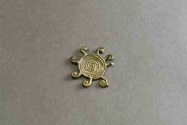 Akan. <em>Gold-weight (abrammuo): geometric</em>, 19th-20th century. Copper alloy, 1/8 x 1 1/2 in. (0.3 x 3.8 cm). Brooklyn Museum, Gift of Mr. and Mrs. Franklin H. Williams, 88.192.102. Creative Commons-BY (Photo: Brooklyn Museum, 88.192.102_front_PS5.jpg)