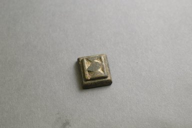 Akan. <em>Gold-weight (abrammuo): geometric</em>, 19th-20th century. Copper alloy, 1 x 7/8 x 3/8 in. Brooklyn Museum, Gift of Mr. and Mrs. Franklin H. Williams, 88.192.116. Creative Commons-BY (Photo: Brooklyn Museum, 88.192.116_front_PS5.jpg)