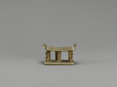 Akan. <em>Gold-weight (abrammuo): stool</em>, 19th-20th century. Cast brass, 1 1/4 x 5/8 x 7/8 in. Brooklyn Museum, Gift of Mr. and Mrs. Franklin H. Williams, 88.192.37. Creative Commons-BY (Photo: Brooklyn Museum, 88.192.37_PS6.jpg)