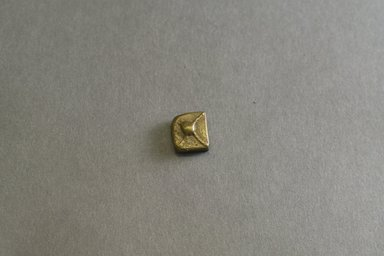 Akan. <em>Gold-weight (abrammuo): geometric</em>, 19th-20th century. Copper alloy, 1/2 x 3/8 x 1/8 in. Brooklyn Museum, Gift of Mr. and Mrs. Franklin H. Williams, 88.192.38. Creative Commons-BY (Photo: Brooklyn Museum, 88.192.38_front_PS5.jpg)