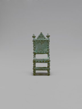 Akan. <em>Gold-weight (abrammuo): throne</em>, 19th-20th century. Cast brass, 1 7/8 x 3/4 x 3/4in. (4.8 x 1.9 x 1.9cm). Brooklyn Museum, Gift of Mr. and Mrs. Franklin H. Williams, 88.192.47. Creative Commons-BY (Photo: Brooklyn Museum, 88.192.47_front_PS6.jpg)